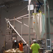 Bulk bags to packaging equipment