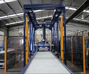 Pallet conveyors integrated into a wall panel stacking system