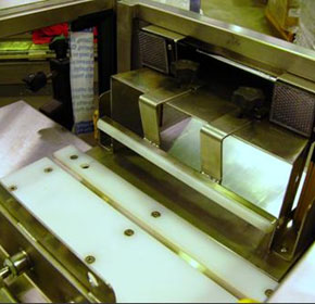 Semi-automatic case packer modifies packaging system