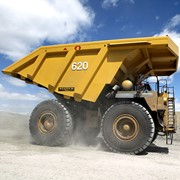 Improved dust control for off-highway dump trucks