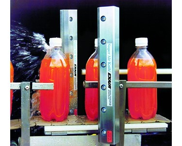 "Bottles exiting a washer are blown dry by 2 x 12"" Super Air Knives prior to labelling."