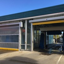A high speed door solution for noise and overspray for carwashes