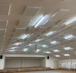 What causes poor acoustics and what are the consequences?