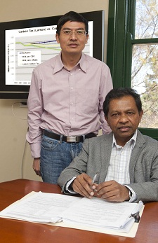Professor Mahinda Siriwardana (seated) and Dr Xianming Meng.