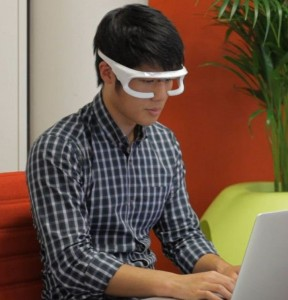 The portable device worn like a pair of sunglasses emits a soft green light onto the eyes.