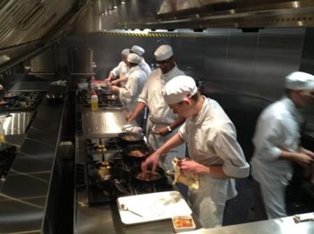 Apprentices cooking in the new commercial kitchen facilities.