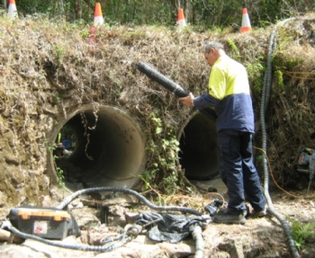 Setting up to restore the integrity of the culverts, before re-supporting the road pavement.