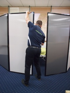 Freestanding privacy screen used to create mobile osteopath clinics in seconds