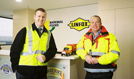 Dematic's Joe Carmody with Linfox's NDC Operations Manager, Travis Small.