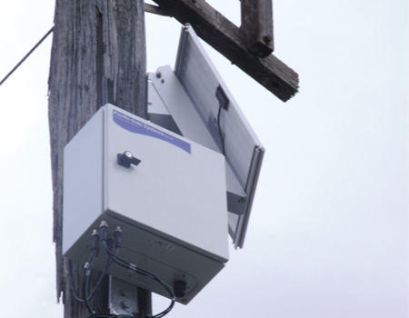 The data logger, modem and battery were housed in a weather-proof enclosure which was installed on a power pole adjacent to the in-ground sensors. Solar panels were also installed to recharge the solution's battery.