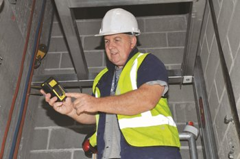 Alex Griffiths checks CO2 levels with the gas detector from Kennards Lift & Shift.