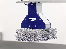 ...shows a needle gripper of the type SNG-Y being used to handle pieces of metal foam.
