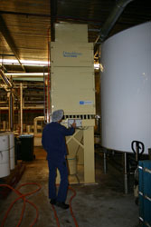 Dust control solution in beverage processing.