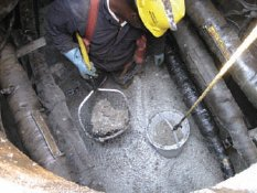 Case Study: Manhole oil & sheen removal