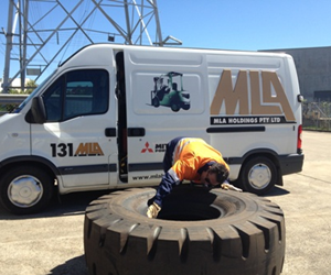 MLA technician inspecting a potentially dangerous 1800 x 25 tyre for any faults.