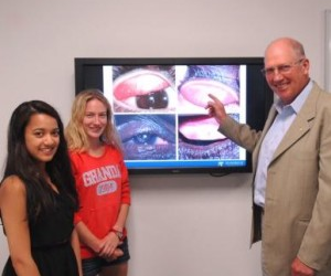 (from left) Fourth-year Master of Optometry students Antara Saha and Kate Weller with Professor Hugh Taylor.
