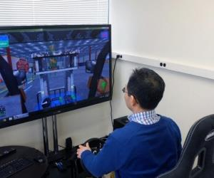 The program allows operators to practice with a video game-like system that features a steering wheel, joystick, pedals and simulated environments.