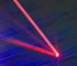 Laser light addressing a single erbium atom in a silicon chip.