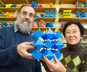 Ray Withers and Yun Liu with the chemical model of the new material. (Image: Australian National University)