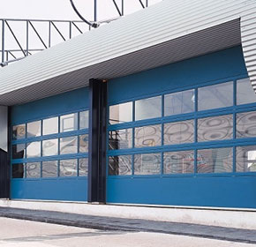 Compact sectional doors as an alternative to overhead doors
