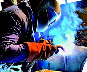 Weld fume rising through a worker's breathing zone