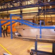 A conveying solution for a continuous dip, molten wax tank
