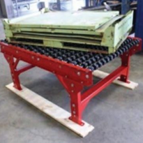 Transfer table helps car manufacturer move heavy steel parts bin