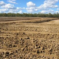 Stabilising clay or dispersive soils