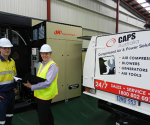 CAPS Australia technicians servicing an oil-free air Ingersoll-Rand compressor.