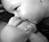 """Infants of a twin pregnancy are recognised to be at risk of problems during pregnancy, particularly from a slowing of the rate of growth in one or both twins."""