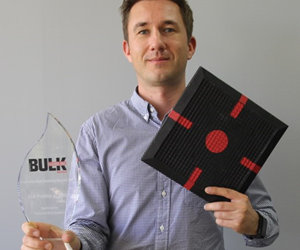 Air Springs Supply Technical Product Manager James Maslin with the bulk handling award