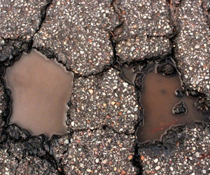 Freeway pothole repair made simple with permanent bagged asphalt