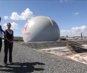 Michael Bambridge, Managing Director of CST Wastewater Solutions and Kelly Hawkins, Biogas Technician at Oakey Beef Exports, with the giant green energy orb in the background