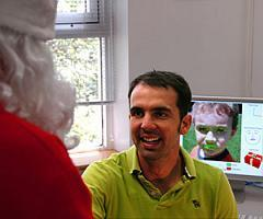 The leader of CSIRO's facial expression recognition technology research team, Dr Simon Lucey, welcoming Santa to the team's research facilities in Sydney. Image by CSIRO.