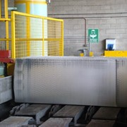 Vertical band saw cuts through 680mm x 1200mm aluminium