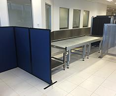 Custom height partitions in Sydney Airport allow the management of people, preventing the blocking thoroughfare when picking up screened bags, but still allowing security sight lines.
